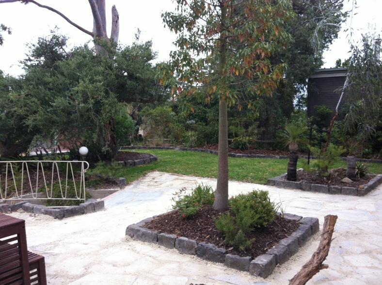 Bluestone as a solid and practical garden bed edging