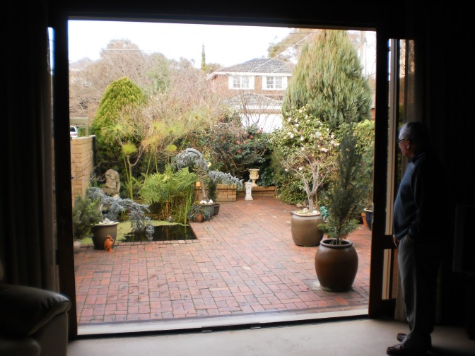 Frank Collings enjoying his garden.