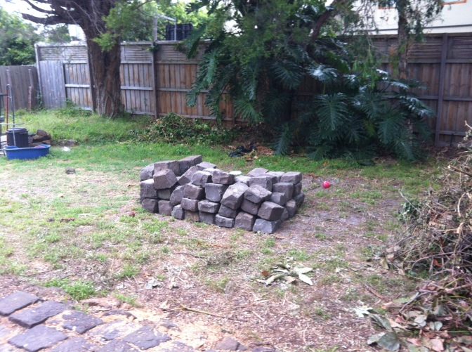 The pile of bluestone begins to build, ready to be rearranged as our new garden edging.