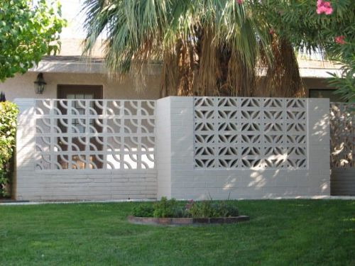 Decorative concrete blocks in the modern landscape grass trees butterfly chairs - Decorative concrete wall blocks ...