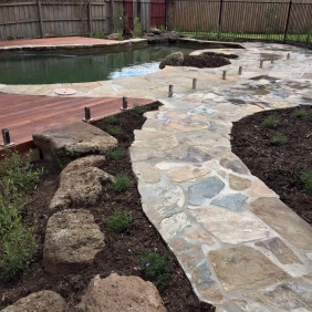 A natural pool with rock features built in the 1970s is complemented by well placed garden rocks in a recent Templestowe project (Photo - Tony Blackford Landscapes)